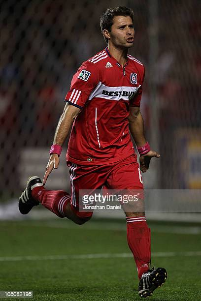 Peter Lowry of the Chicago Fire celebrates scoring the 600th goal in the 13 year history of the Fire in the first half against the Columbus Crew in...