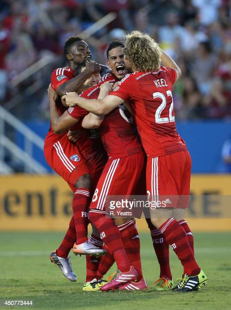 Peter Luccin Stephen Keel Victor Ulloa and Fabian Castillo of FC Dallas celebrate against the Colorado Rapids at Toyota Stadium on June 7 2014 in...