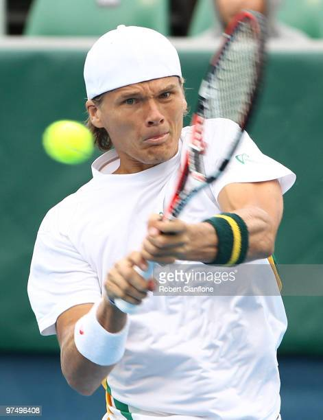 Peter Luczak of Australia plays a backhand duiring his match against TsungHua Yang of Chinese Taipei during day three of the Davis Cup AsiaOceania...