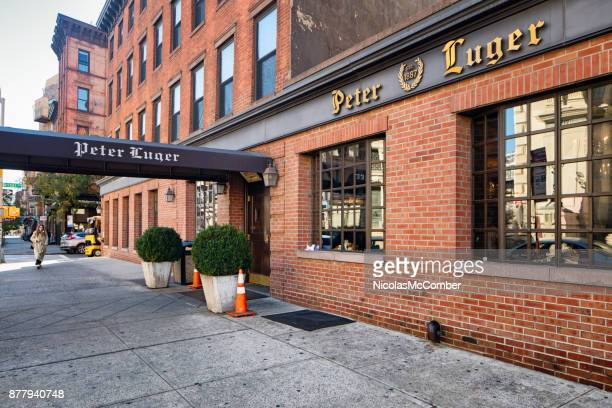 peter luger steak house in williamsburg brooklyn facade view - steakhouse stock photos and pictures