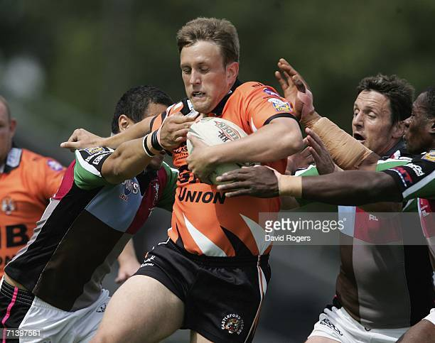 Peter Lupton of Castleford is stopped by the Harlequin defence during the Super League XI match between Harlequins RL and Castleford Tigers on July 8...