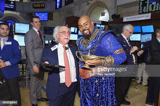 Peter M Tuchman of Quattro Securities and actor and singer James Monroe Iglehart pose for pictures prior to ringing the opening bell at the New York...