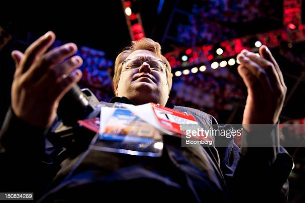 Peter Mackin an alternate delegate from Michigan prays during the Republican National Convention in Tampa Florida US on Monday Aug 27 2012 The first...