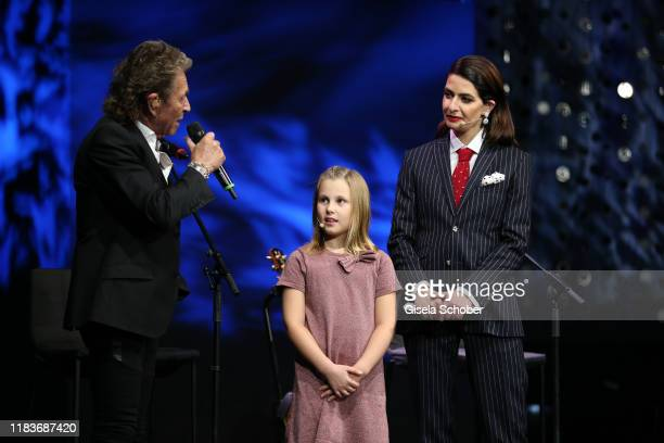 Peter Maffay and child and Linda Zervakis during the Tribute To Bambi show at Casino BadenBaden on November 20 2019 in BadenBaden Germany