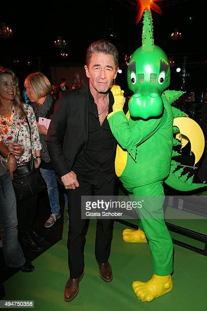 Peter Maffay and dragon Tabaluga during the 'Tabaluga Es lebe die Freundschaft' record release at Das Schloss on October 28 2015 in Munich Germany