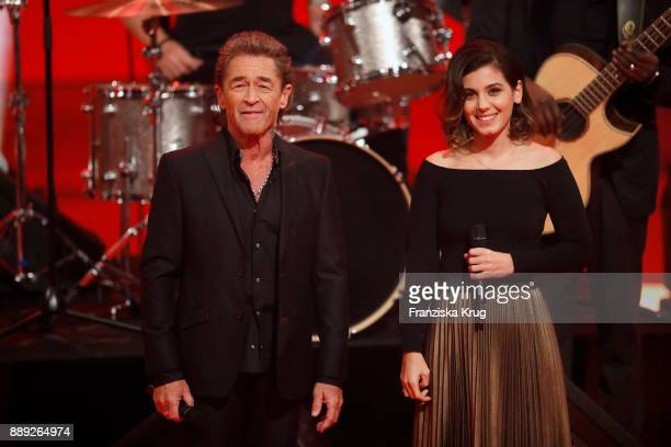 Peter Maffay and Katie Melua perform at the Ein Herz Fuer Kinder Gala show at Studio Berlin Adlershof on December 9 2017 in Berlin Germany