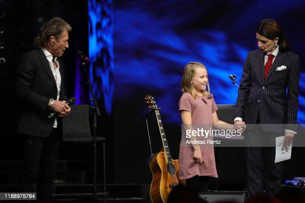 Peter Maffay guest and Linda Zervakis speak on stage at the Tribute To Bambi show at Kurhaus BadenBaden on November 20 2019 in BadenBaden Germany