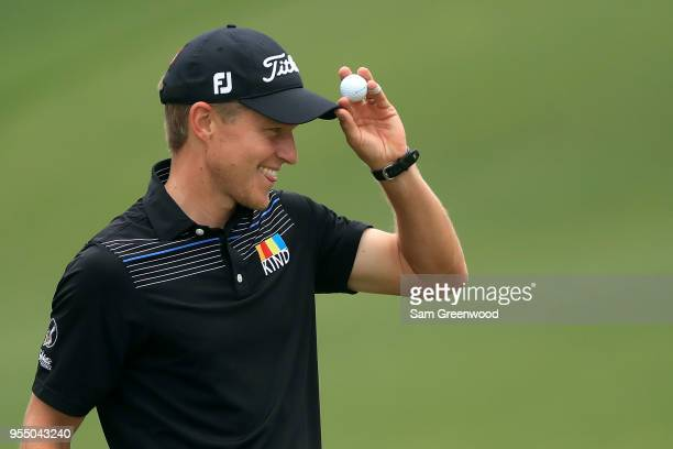 Peter Malnati acknowledges the gallery following his birdie putt on the first hole during the third round of the 2018 Wells Fargo Championship at...