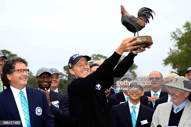 Peter Malnati hoists the trophy following a victory at the Sanderson Farms Championship on November 9 2015 in Jackson Mississippi