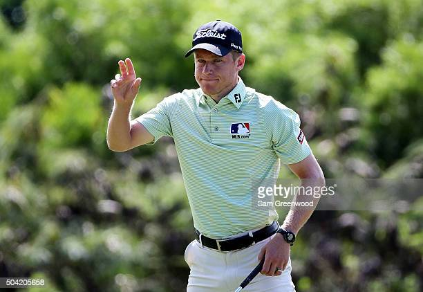 Peter Malnati holds up his ball after putting on the eighth green during the third round of the Hyundai Tournament of Champions at the Plantation...