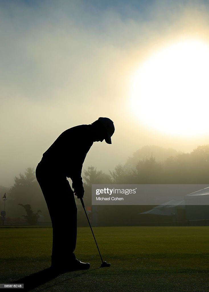 Peter Malnati of the United States practices putting during a delay due to the fog prior to the first round on August 4, 2016 in Cromwell, Connecticut.
