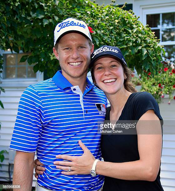 Peter Malnati poses for a photo with his wife Alicia Malnati after his round of golf during the first round of the travelers Championship at TPC...