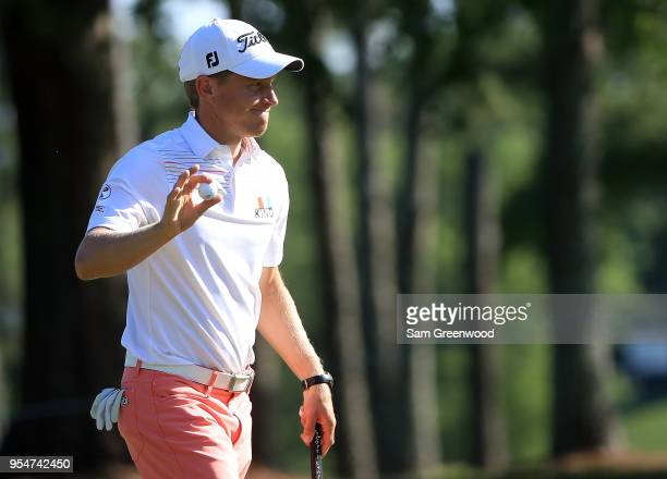Peter Malnati reacts after his par putt on the ninth green during the second round of the 2018 Wells Fargo Championship at Quail Hollow Club on May 4...