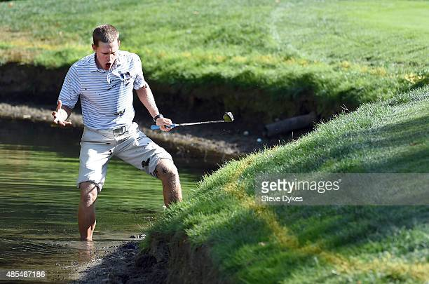 Peter Malnati reacts to his attempt to hit out of the edge of a pond on the 12th hole during the first round of the WinCo Foods Portland Open on...