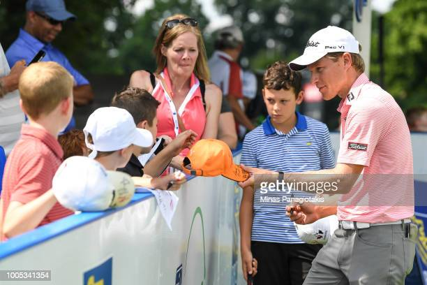 Peter Malnati sign autographs during the practice rounds at the RBC Canadian Open at Glen Abbey Golf Club on July 25 2018 in Oakville Canada