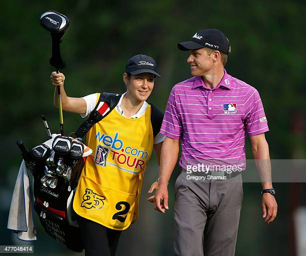 Peter Malnati talks with is caddie and wife Alicia Malnati after his second shot on the 14th hole during the third round of the Webcom Tour RustOleum...