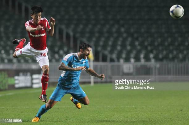 Peter Man Peitak of South China struggles with Pablo Gonzalez of Kitchee in FA Cup semifinal second leg Hong Kong Stadium 28APR13