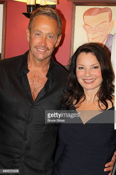Peter Marc Jacobson and exwife Fran Drescher pose in honor of Drescher's performance in Broadway's 'Cinderella' she gets her caricature unveiled at...