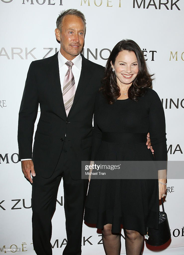 Peter Marc Jacobson and Fran Drescher arrive at Mark Zunino Atelier opening held on January 7, 2016 in Beverly Hills, California.