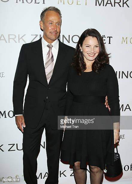 Peter Marc Jacobson and Fran Drescher arrive at Mark Zunino Atelier opening held on January 7 2016 in Beverly Hills California