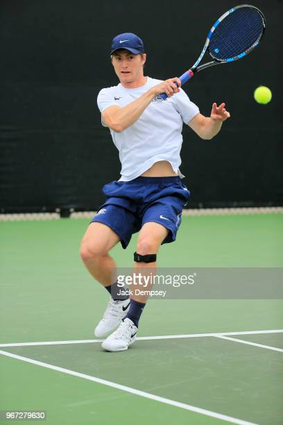Peter Martin of the Middlebury Panthers hits a forehand against the Bowdoin Polar Bears during the Division III Men's Tennis Championship held at the...