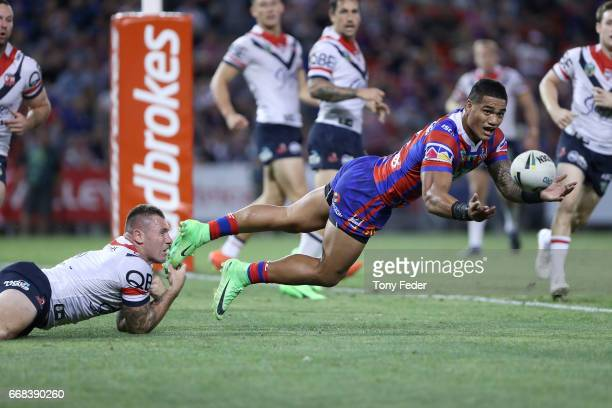 Peter Mata' Utia of the Knights gets his pass away during the round seven NRL match between the Newcastle Knights and the Sydney Roosters at McDonald...