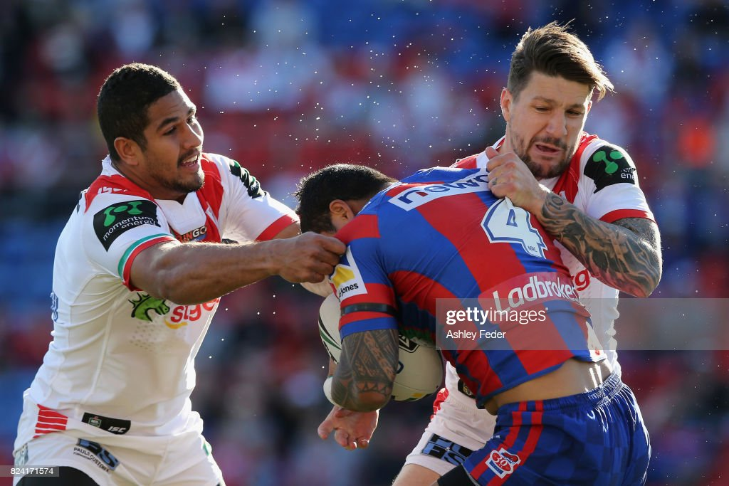 Peter Mata'Utia of the Knights is tackled by Gareth Widdop (right) of the Dragons during the round 21 NRL match between the Newcastle Knights and the St George Illawarra Dragons at McDonald Jones Stadium on July 29, 2017 in Newcastle, Australia.