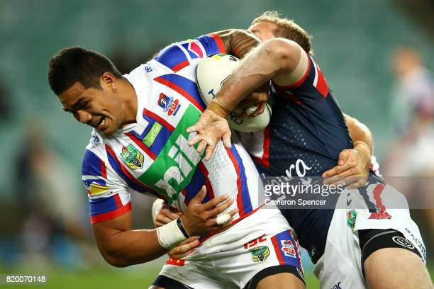 Peter Mata'utia of the Knights is tackled during the round 20 NRL match between the Sydney Roosters and the Newcastle Knights at Allianz Stadium on...