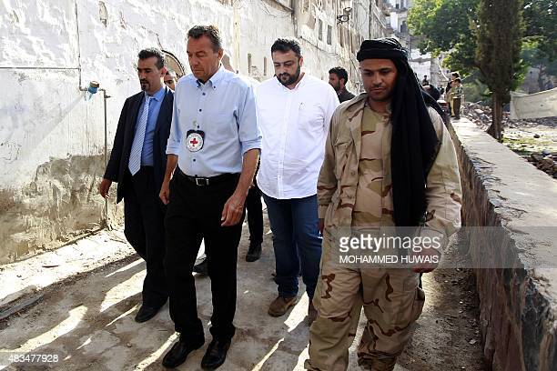 Peter Maurer , president of the International Committee of the Red Cross , is escorted as he tours the old city of Yemeni capital Sanaa, on August 9,...