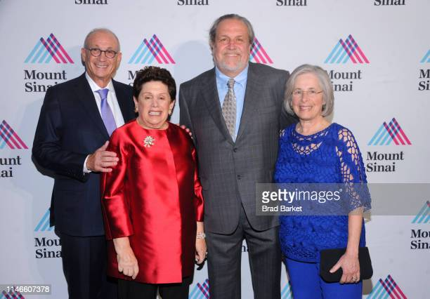 Peter May, Leni May, Dr. Dennis Charney and Andrea Charney attend Mount Sinai Health System 2019 Crystal Party at Central Park Conservatory Garden on...