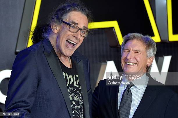 Peter Mayhew and Harrison Ford attend the European Premiere of Star Wars The Force Awakens at Leicester Square on December 16 2015 in London England