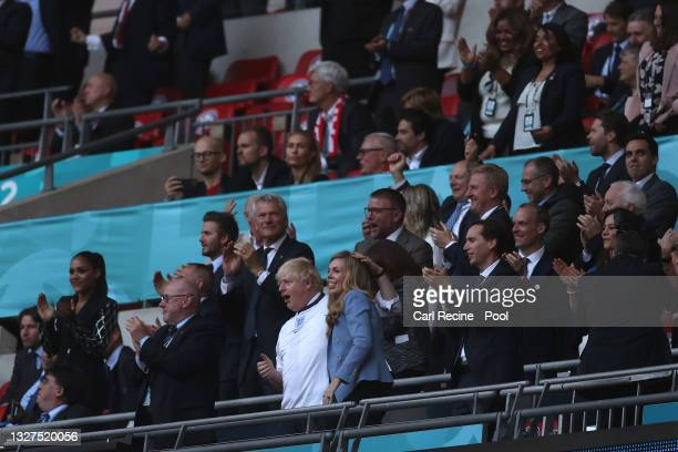 Peter McCormick, Interim Chairman of the Football Association, Boris Johnson, Prime Minister of United Kingdom and his wife, Carrie Johnson celebrate...