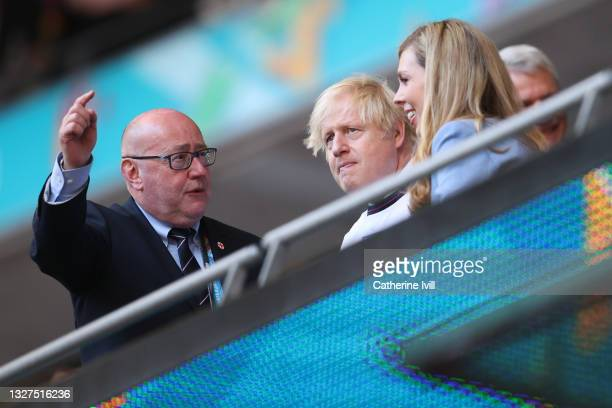 Peter McCormick, Interim Chairman of the Football Association , speaks with Boris Johnson, Prime Minister of England, and Carrie Johnson, wife of...