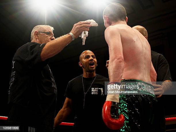 Peter McDonagh of Bermondsey exchanges words with the trainer of Curtis Woodhouse of Driffield after the LightWelterweight bout at York Hall on...