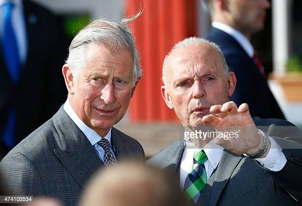 Peter McHugh speaks to Britain's Prince Charles, Prince of Wales and his wife Camilla, Duchess of Cornwall as they visit the village of Mullaghmore,...