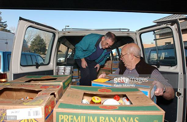 Peter McInnes and Bill McMickle of the Littleton Church of Christ collect donated food at the Food Bank of the Rockies January 29 2003 in Denver...