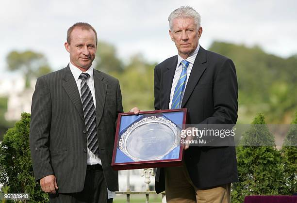 Peter McKay trainer of Joey Massino receives the winning shield for the New Zealand Bloodstock Insurance Karaka 3 year old Mile from Jim Bruford of...