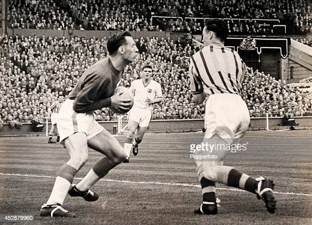 Peter McParland of Aston Villa about to crash into Manchester United goalkeeper Ray Wood fracturing his jaw whilst Duncan Edwards watches during the...