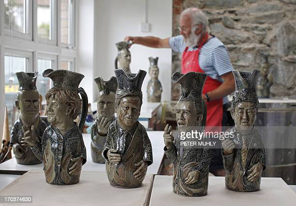 Peter Meanley Head of Ceramics at the University of Ulster poses for pictures with his Toby jugs depicting the G8 leaders in his studio in Bangor...