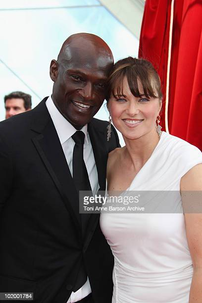 Peter Mensah and Lucy Lawless arrives at the Monte Carlo TV Festival Closing Ceremony at the Grimaldi Forum on June 10 2010 in MonteCarlo Monaco