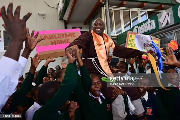 TOPSHOT Peter Mokaya Tabichi winner of the renowned Global Teacher's Prize is welcomed by his students on March 27 2019 upon arrival at Nairobi's...