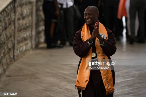 Peter Mokaya Tabichi winner of the renowned Global Teacher's Prize reacts to cheers from his students on March 27 2019 upon arrival at Nairobi's Jomo...