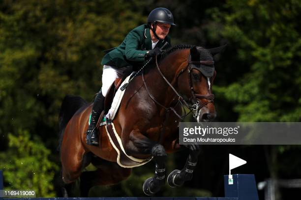 Peter Moloney of Ireland riding Chianti's Champion competes during Day 3 of the Longines FEI Jumping European Championship speed competition against...