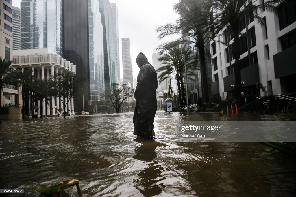 Peter Moodley wades through floodwater caused by the storm surge to assess the damage for himself, as the full effect of Hurricane Irma struck Miami, Fla., on Sept. 10, 2017.