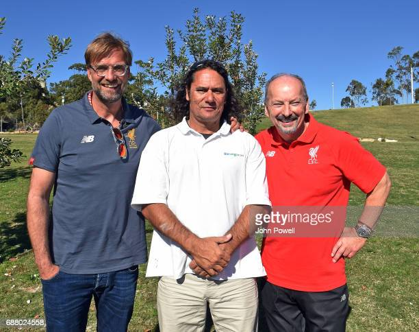 Peter Moore CEO of Liverpool and Jurgen Klopp manager of Liverpool pose for a photograph with Clarence Slockee during a Aboriginal culture tour on...