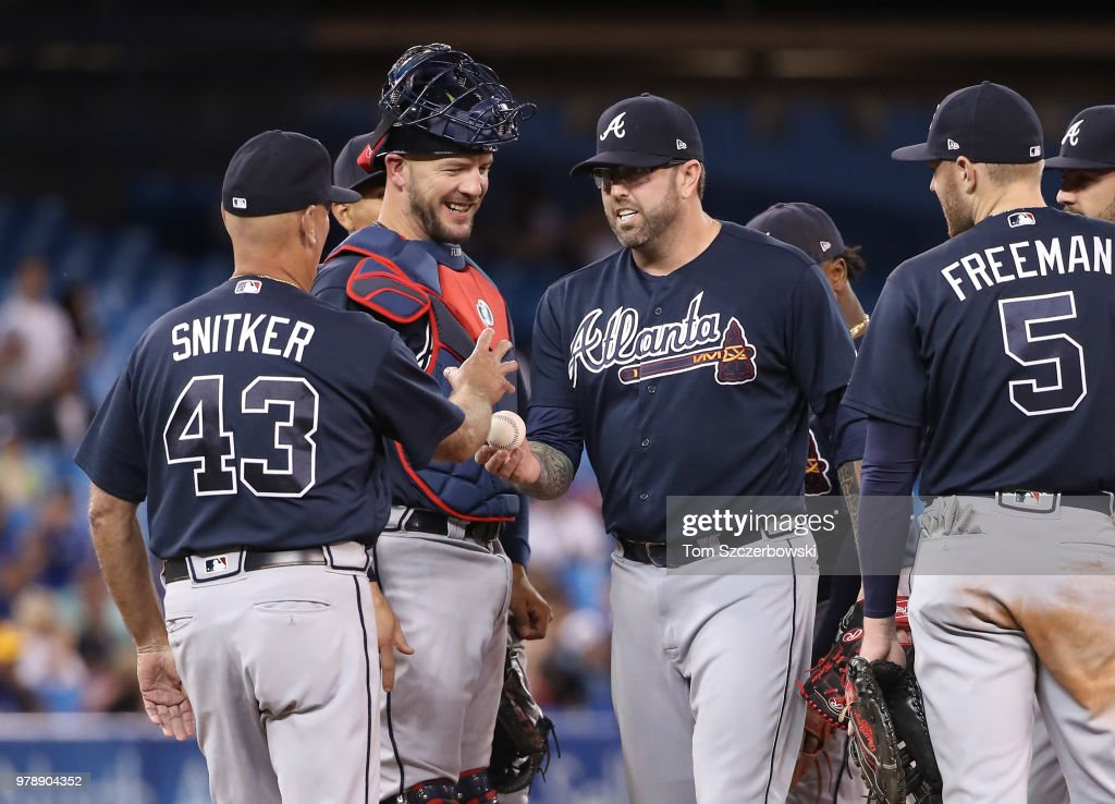 Peter Moylan #30 of the Atlanta Braves exits the game as he is relieved by manager Brian Snitker #43 in the sixth inning during MLB game action against the Toronto Blue Jays at Rogers Centre on June 19, 2018 in Toronto, Canada.