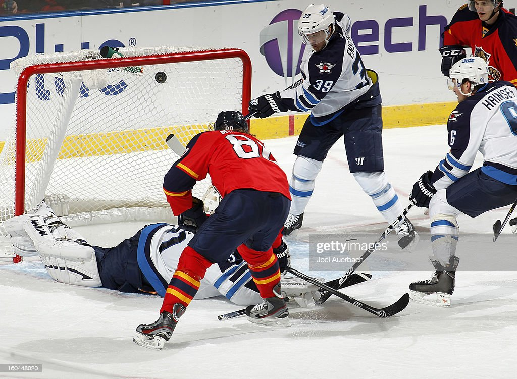 Peter Mueller #88 of the Florida Panthers scores a goal over Goaltender Ondrej Pavelec #31 of the Winnipeg Jets at the BB&T Center on January 31, 2013 in Sunrise, Florida. The Panthers defeated the Jets 6-3.