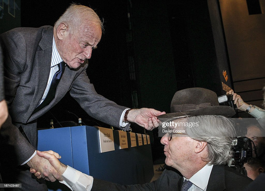 Peter Munk, Founder and Chairman of Barrick Gold places his trademark hat on the head of board member John L. Thornton after their Annual General Meeting being held at the Metro Toronto Convention Centre.