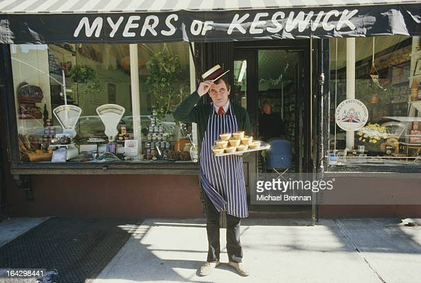 Peter Myers stands outside his British grocery store Myers of Keswick in New York City 1986