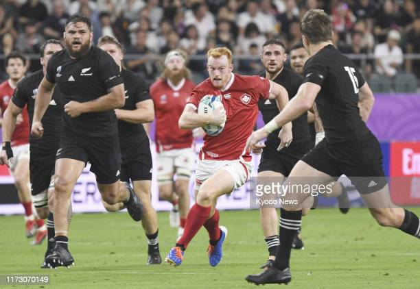 Peter Nelson of Canada runs with the ball during the first half of a Rugby World Cup Pool B match against New Zealand on Oct 2 in Oita southwestern...